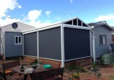blue character in Perth with ziptrak blinds all the way down to protect the deck and verandah.