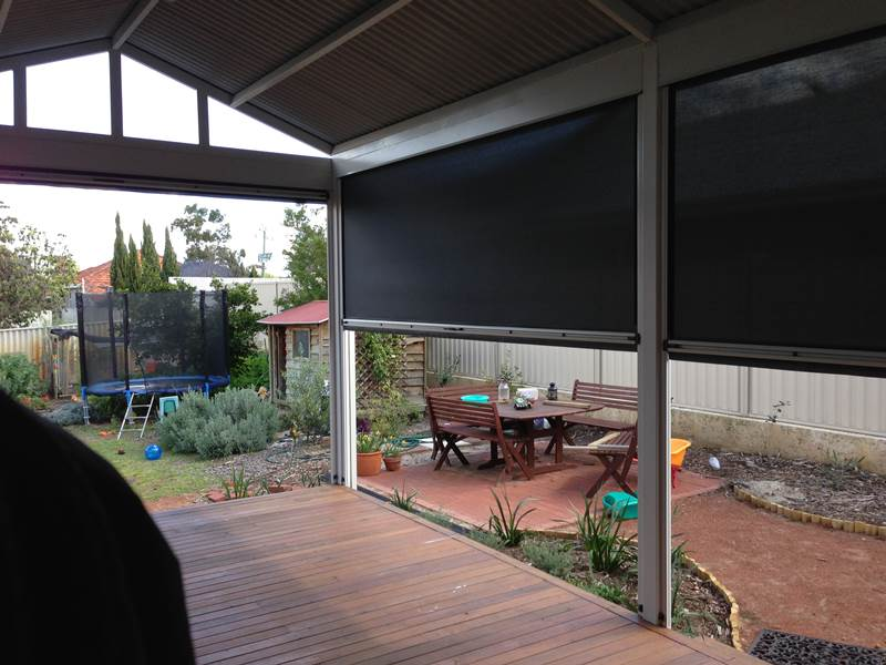 Looking Out From Verandah With Dark Mesh Outdoor Blinds.