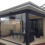 clear plastic ziptrak blinds that have created an enclosed outdoor room.