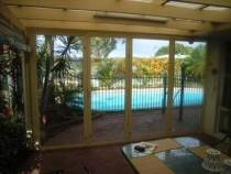 looking through bi fold pvc doors to pool