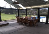 8 person dining table in alfresco area with patio blinds