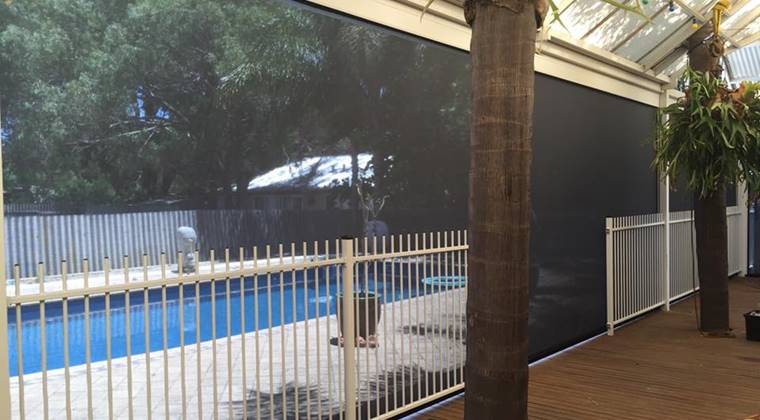 patio blind install in guildford looking out to pool