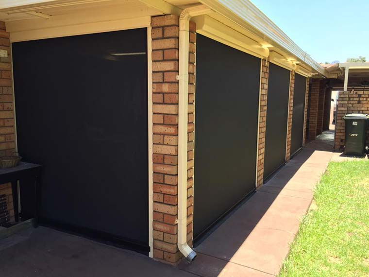 brick patio area with blinds