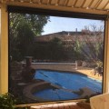 looking through blinds to pool