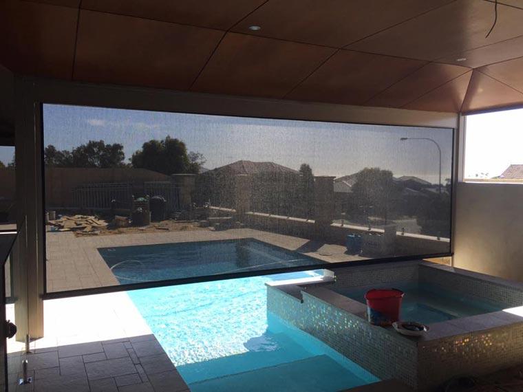 dark mesh ziptrak blind over pool