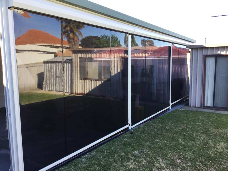 back garden patio protected with outdoor blinds.