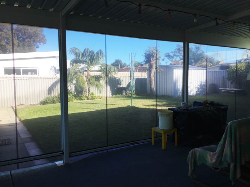 looking out through clear ziptrak patio blinds.