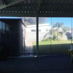 back patio fitted with clear blinds.