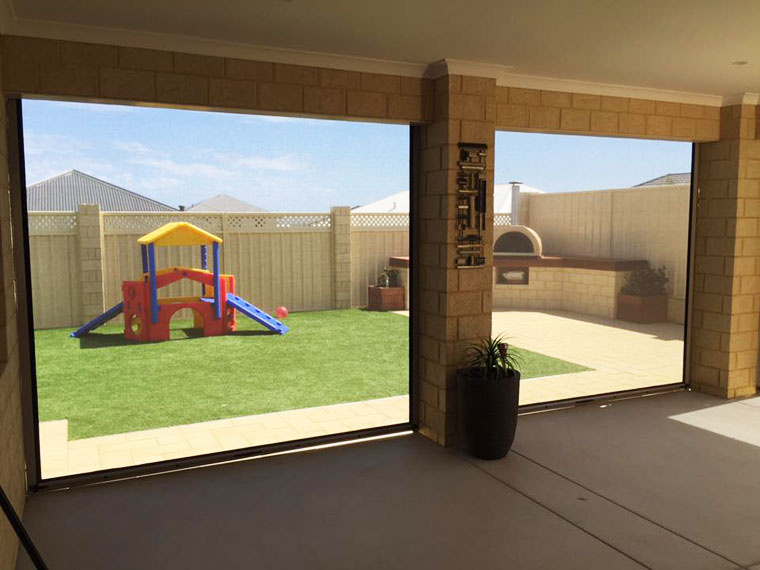 jindalee alfresco blinds looking out to kids play area in backyard