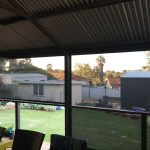 raised deck area with shade patio blinds