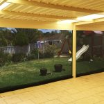 entertaining area and grass yard with toys.