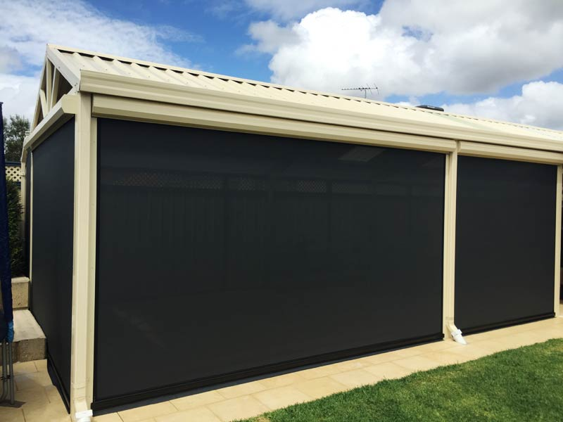 fully enclosed room created with dark shade blinds.
