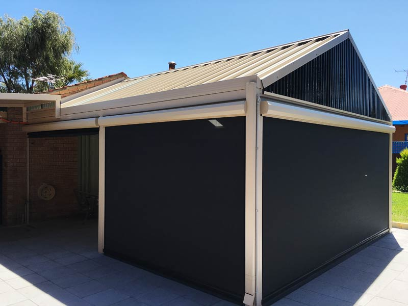 steel patio with blinds connected to brick home.