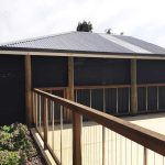 wooden rail pool fence and patio with ziptrak blinds.