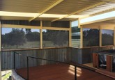 covered patio deck with blinds for sun, rain and wind protection.