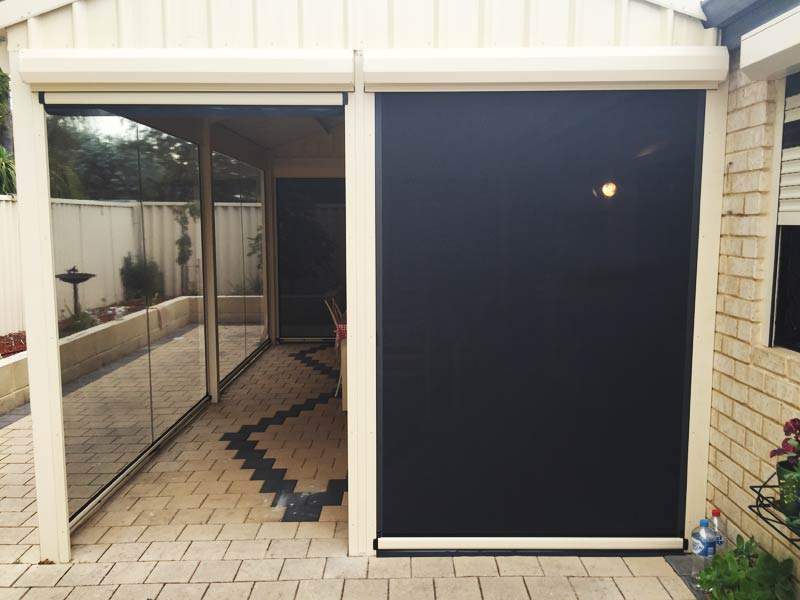 side patio protected by shade mesh blinds and back section installed with clear plastic blinds.
