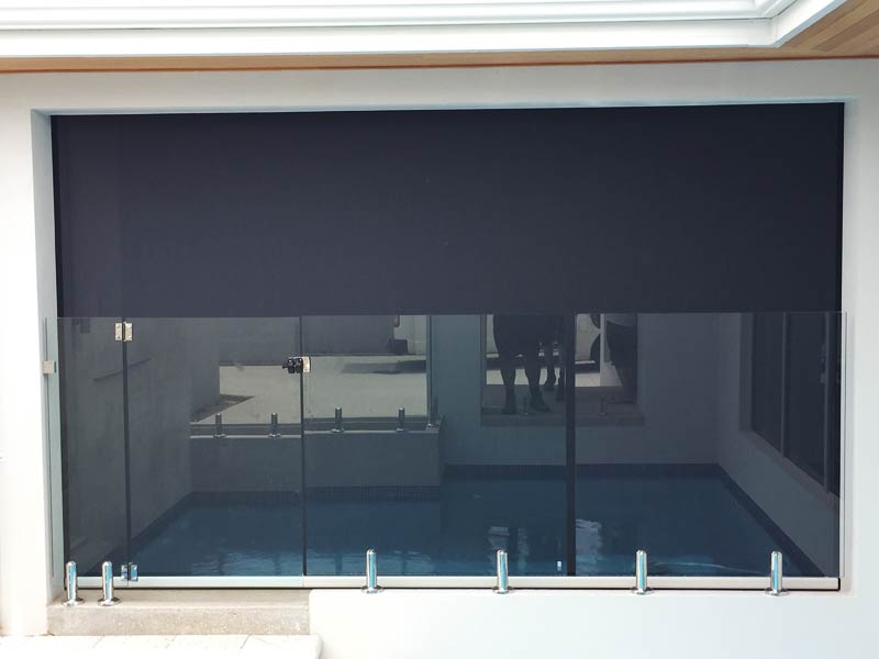 wide outdoor blind with pool behind