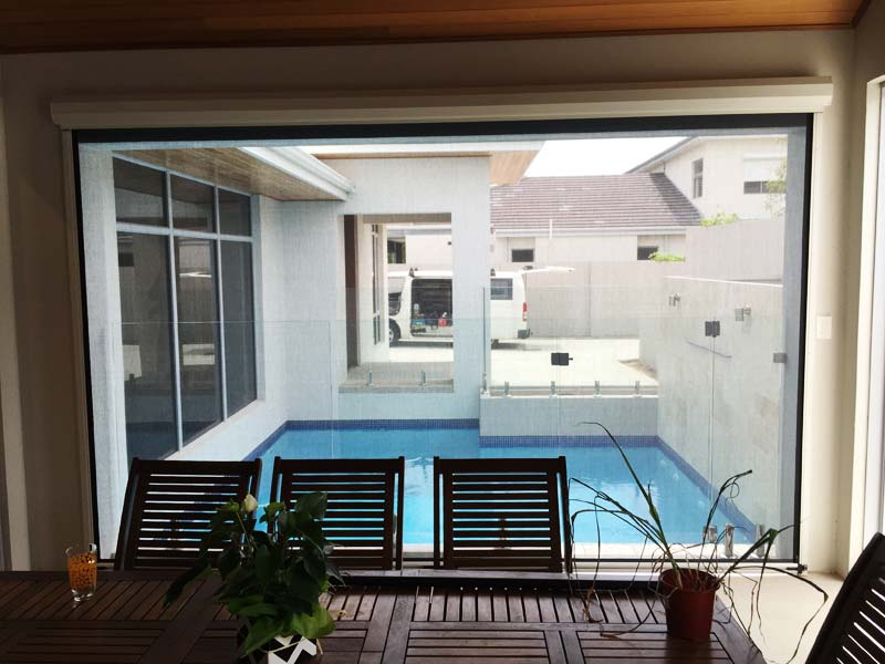 alfresco dining area with blinds rolled down