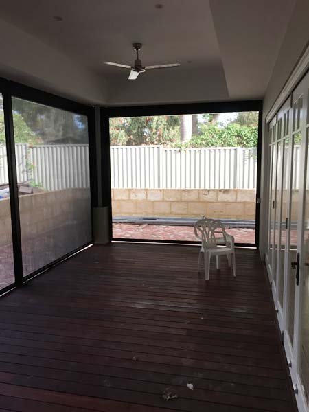 enclosed wooden deck in backyard with ziptrak blinds fitted