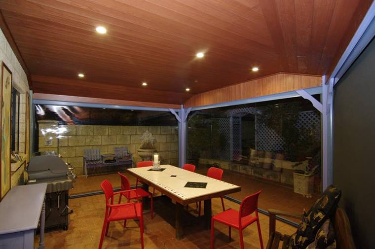 patio blinds create new room perfect for alfresco dining.