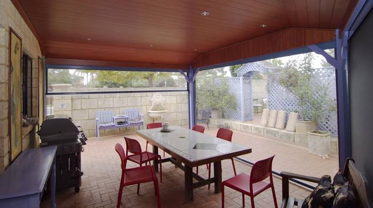 the new room created by the patio blinds is perfect for meals and entertaining.