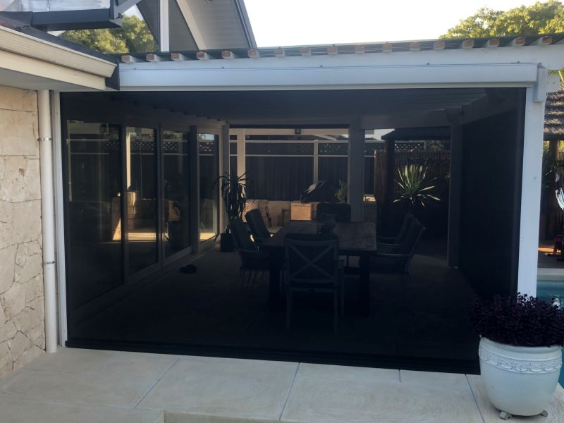 dark shade mesh outdoor blinds protecting the patio