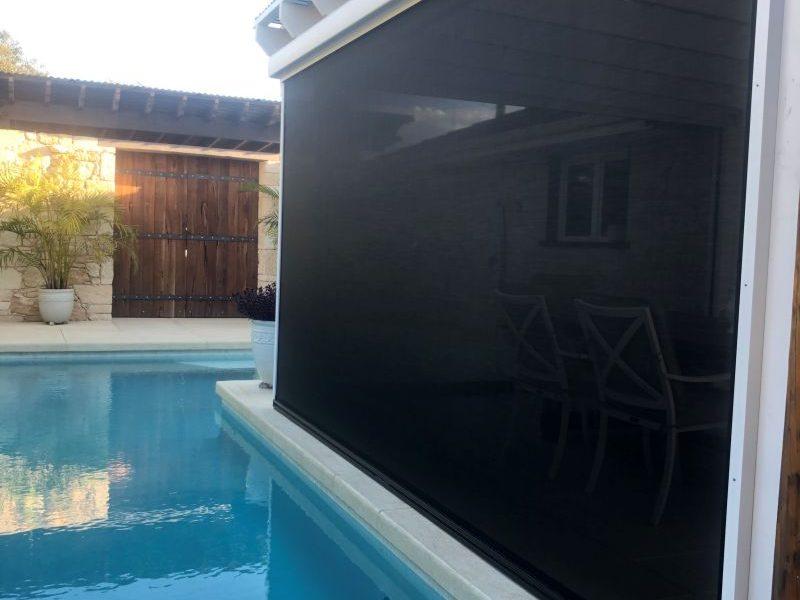 ziptrak outdoor blinds next to pool