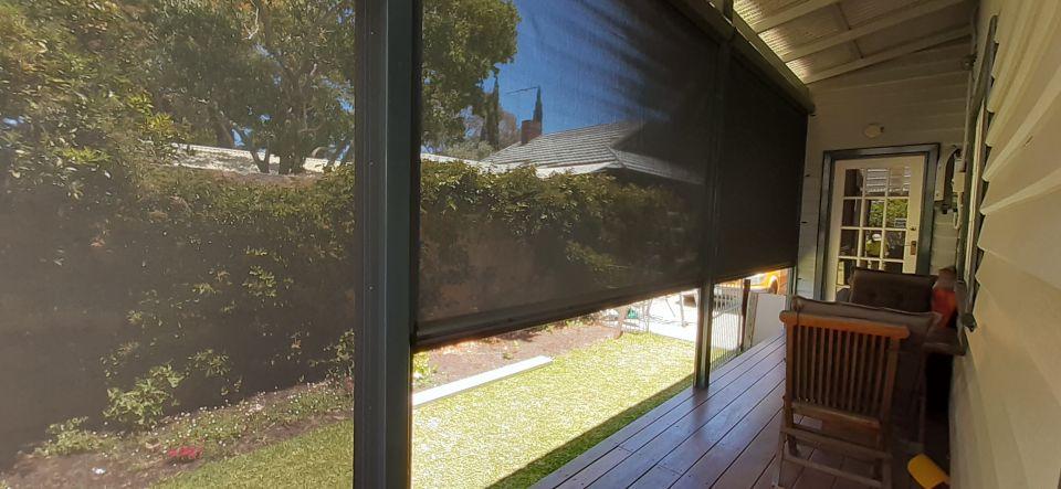 looking out through ziptrak blinds on verandah in fremantle
